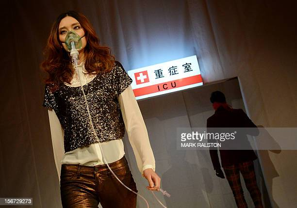 A model wears a face mask during the Toxic Threads The Big Fashion Stitchup fashion parade organized by environment action group Greenpeace to...