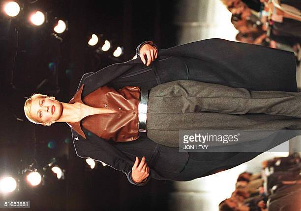 Model wears a full length wool coat over a brown leather shirt and grey wool pants in the Ralph Lauren Fall 1997 Collection 09 April in New York....