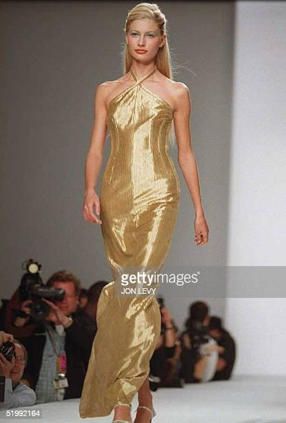 Model wears a gold metallic, tech lace halter dress at the Richard Tyler Spring 1996 fashion collection show 31 October in New York. AFP PHOTO