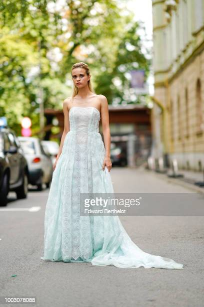 A model wears a green lace mesh wedding dress outside Cindyalan during Feeric Fashion Week 2018 on July 21 2018 in Sibiu Romania