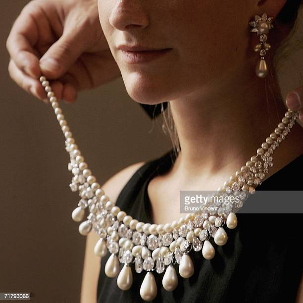 Model wears a Gulf Pearl Necklace at Christies auction house on September 6, 2006 in London, England. The necklace, part of the 'Harry Winston'...