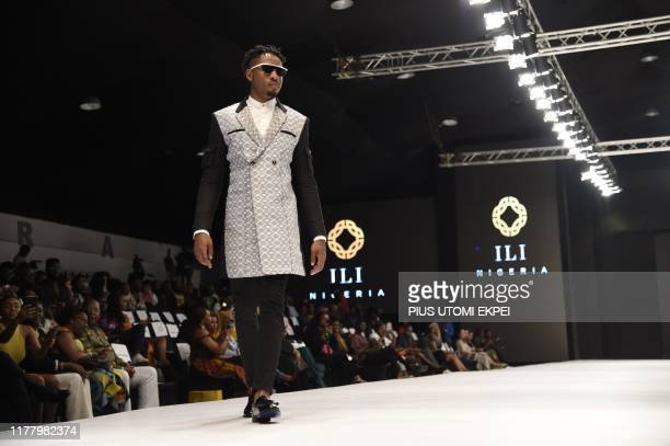 Model wears a ILI Naolila creation during the yearly Lagos Fashion Week in Lagos, on October 24, 2019. - Lagos Fashion Week is a fashion platform...