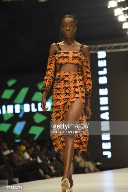 Model wears a Jermaine Bleu creation during the yearly Lagos Fashion Week in Lagos, on October 24, 2019. - Lagos Fashion Week is a fashion platform...