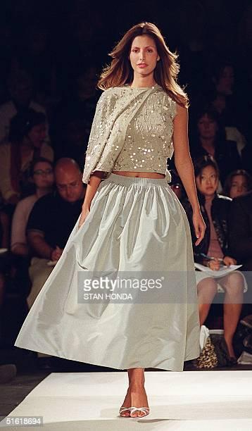 A model wears a khaki cashmere and silk beaded sweater set and ash silk taffeta skirt during the Oscar de la Renta fashion show 14 September 1999 at...