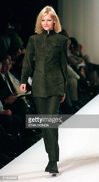 A model wears a leather jacket with a Nehrustyle collar and trousers during the Ralph Lauren FallWinter fashion show 01 April in New York The...