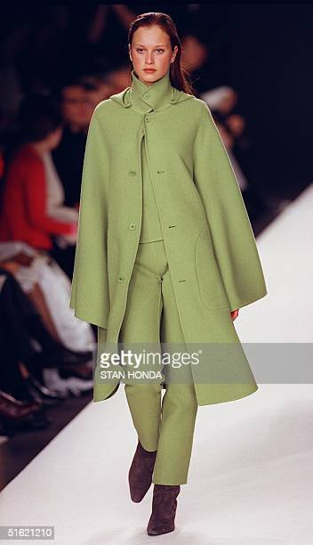 A model wears a lime double face cashmere cape over a cashmere shell and cashmere pants during the Ralph Lauren fashion show 17 February in New York...
