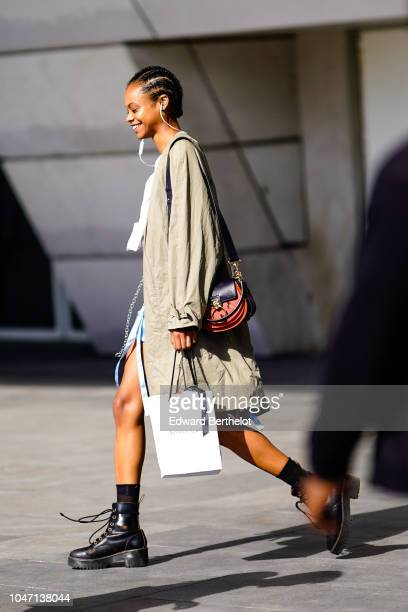 A model wears a long jacket a Gucci bag black leather shoes outside Giambattista Valli during Paris Fashion Week Womenswear Spring/Summer 2019 on...