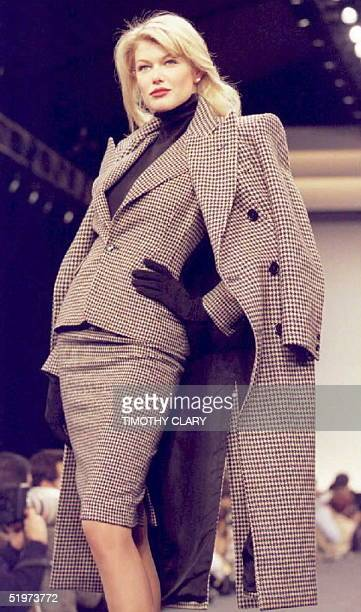 A model wears a matching tweed suit and coat during the Ralph Lauren Fall 1995 fashion show in New York 05 April AFP PHOTO
