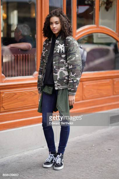 A model wears a military camo print bomber jacket outside Giambattista Valli during Paris Fashion Week Womenswear Spring/Summer 2018 on October 2...
