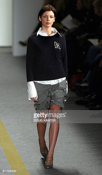 A model wears a navy angora monogram sweater cotton shirt and gray skirt at the DKNY Fall 2002 fashion show in New York 12 February 2002 AFP...