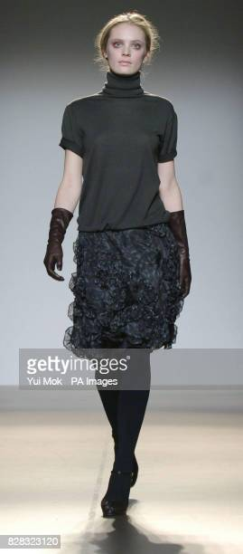 A model wears a Nicole Farhi creation during the designer label's London Fashion Week Autumn/Winter 2006 show from the Floral Hall of the Royal Opera...