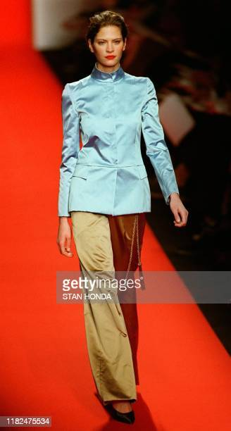 A model wears a pale blue satin jacket over a cappuchino pant with an embroidered belt during the Caroline Herrera fashion show 15 February in New...