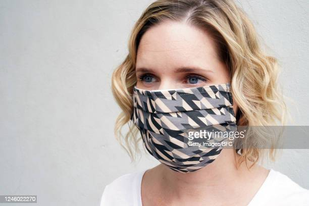 Model wears a personal protection mask designed by Mulberry on June 04, 2020 in London, England.As part of the British Fashion Councils fightback...