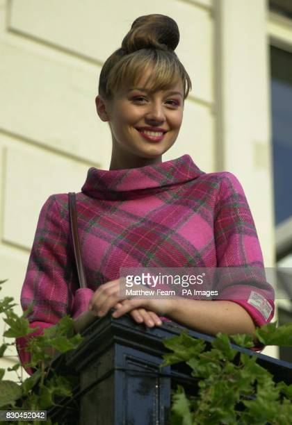 A model wears a pink check Harris Tweed dress by Susy Harper during a reception to launch the new face of Harris Tweed at the Scottish Office in...