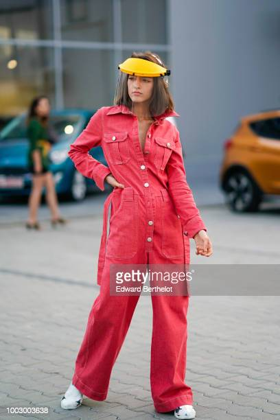 A model wears a pink denim jumpsuit white sneakers during Feeric Fashion Week 2018 on July 20 2018 in Sibiu Romania