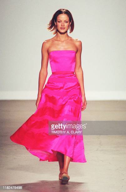 Model wears a pink dress during the Isaac Mizrahi Fall/Winter fashion shows 03 April in New York. The collection is part of the 7th on Sixth New York...