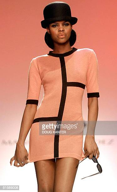 A model wears a pink sweater with black lines in angora wool at the Manuel Fernandez show during Fall 2001 Fashion Week in New York 11 February 2001...