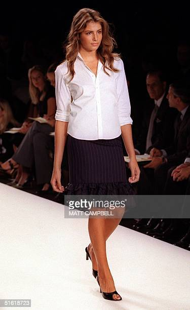 A model wears a pinstriped ruffled skirt and a white collared shirt during the Ralph Lauren fashion show at the Fashion Week Spring 2000 Collections...