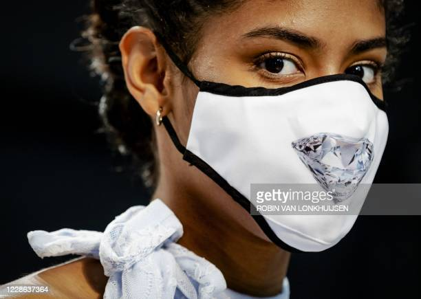 Model wears a protective mask with an image of a diamond during the modified ninth edition of the Canal Catwalk, the annual fashion show that takes...