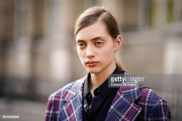 A model wears a purple checkered blazer jacket outside the Dries Van Noten show during Paris Fashion Week Womenswear Spring/Summer 2018 on September...