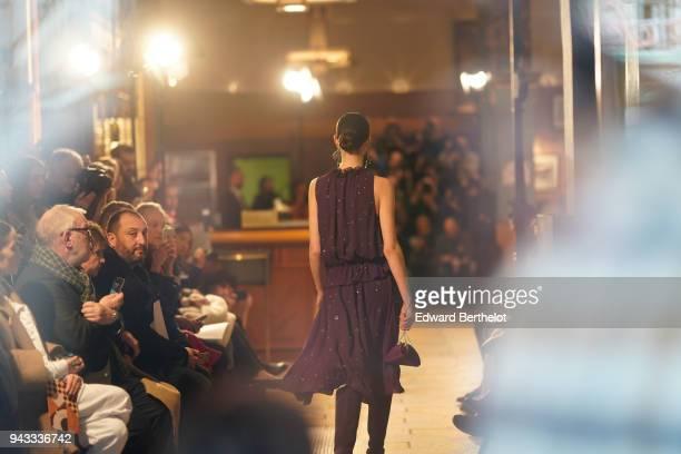 A model wears a purple dress and walks towards the photographers on the catwalk during Altuzarra during Paris Fashion Week Womenswear Fall/Winter...