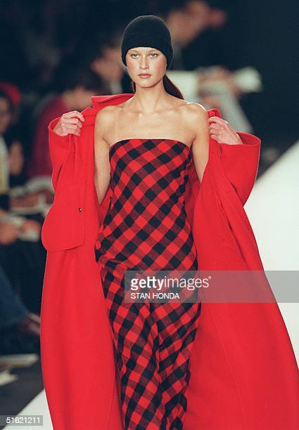 A model wears a red lambswool check dress under a red cashmere coat during the Ralph Lauren fashion show 17 February in New York The show is part of...