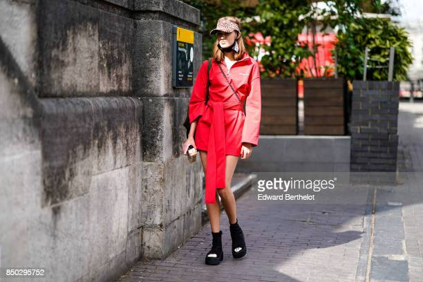 A model wears a red outfit outside Roland Mouret during London Fashion Week September 2017 on September 17 2017 in London England