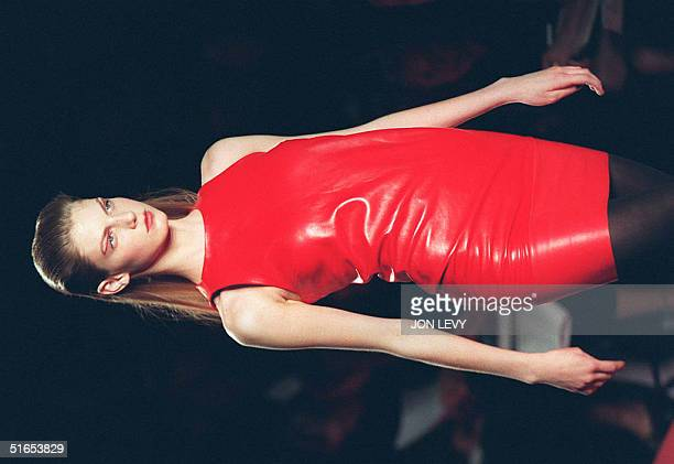 A model wears a red sleeveless sheath dress in the showing of the D by DKNY Fall 1997 fashion show 06 April in New York Fashion week in New York runs...