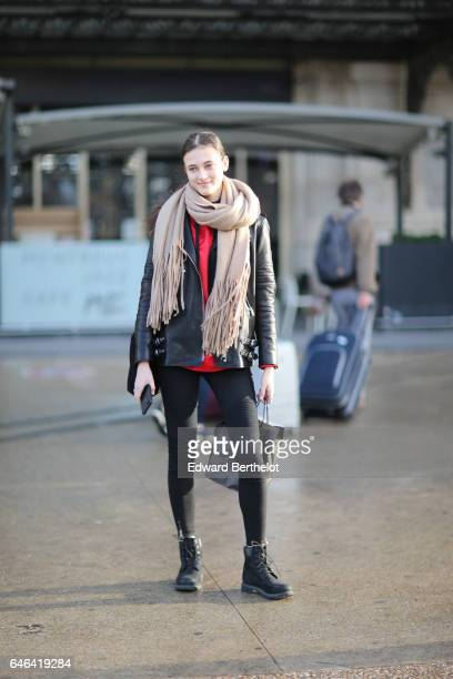 A model wears a scarf a red top and a black leather jacket outside the Olivier Theyskens show during Paris Fashion Week Womenswear Fall/Winter...