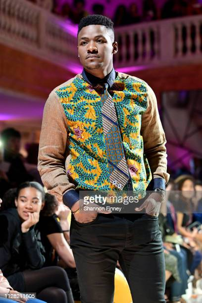 A model wears a shirt from the designer 2Heads by Atsu with accessories by Dara Oji Collections at the District of Fashion Fall/Winter 2019 Runway...