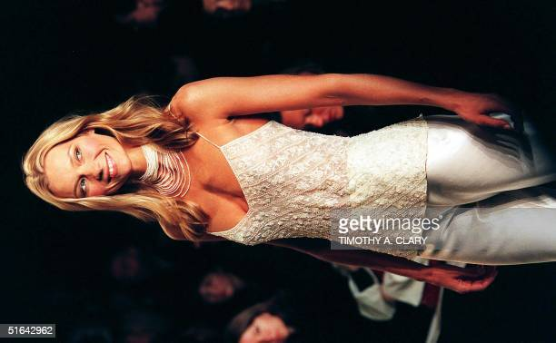 A model wears a silver satin sequined top with silk pants during the Ralph Lauren 1998 spring/summer fashion collection 05 November in New York City...