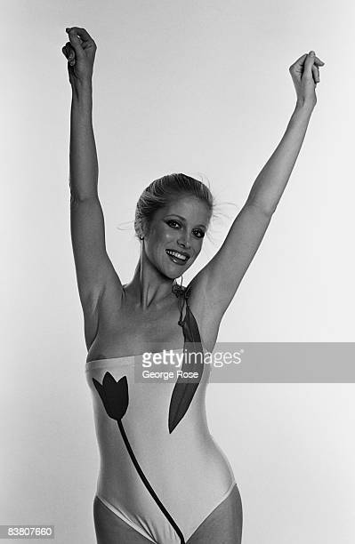 A model wears a sleek maillot tulip bathing suit by designer Keiko in this 1980 Los Angeles California studio photo shoot
