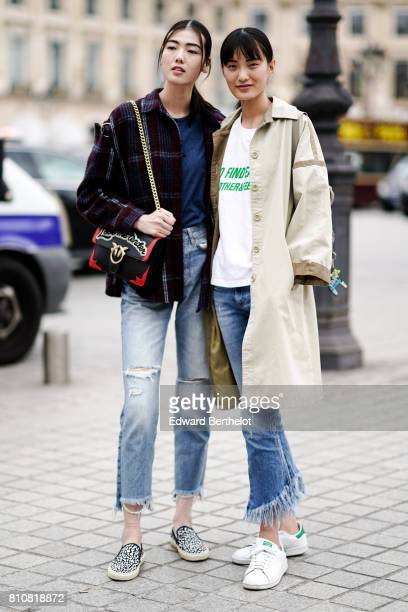 A model wears a tartan checkered jacket a black and redd bag cropped jeans shoes a model wears a trench coat a white tshirt with green printed words...