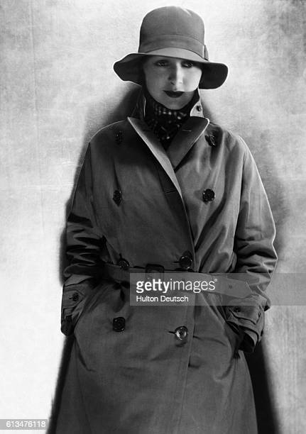 A model wears a trench coat and hat supplied by the classic clothing retailers Burberry