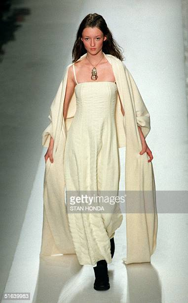 A model wears a white fleece lined chiffon dress and stole during the DKNY FallWinter collection show 29 March in New York The collection by Donna...