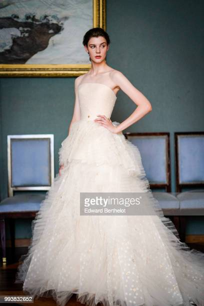 A model wears a white lace dress after the Ulyana Sergeenko Haute Couture Fall Winter 2018/2019 show as part of Paris Fashion Week on July 3 2018 in...