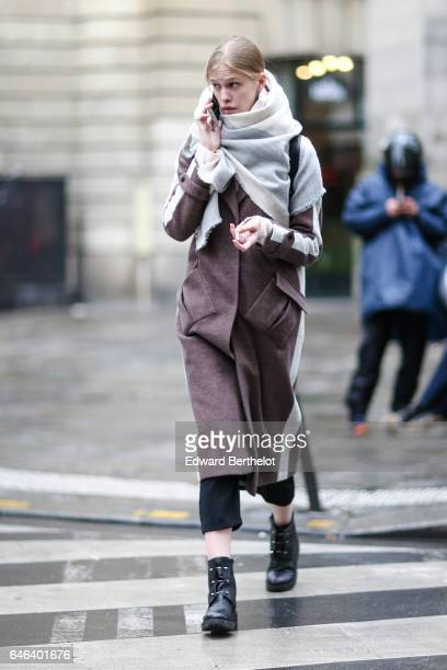 A model wears a white scarf and a purple long coat outside the JOUR/NE show during Paris Fashion Week Womenswear Fall/Winter 2017/2018 on February 28...