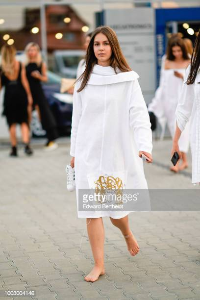 A model wears a wite dress during Feeric Fashion Week 2018 on July 20 2018 in Sibiu Romania