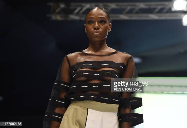 Model wears a Wuman creation during the yearly Lagos Fashion Week in Lagos, on October 24, 2019. - Lagos Fashion Week is a fashion platform bringing...