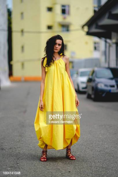 A model wears a yellow dress during Feeric Fashion Week 2018 on July 22 2018 in Sibiu Romania