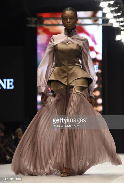 Model wears a Yutee Rone creation during the yearly Lagos Fashion Week in Lagos, on October 24, 2019. - Lagos Fashion Week is a fashion platform...