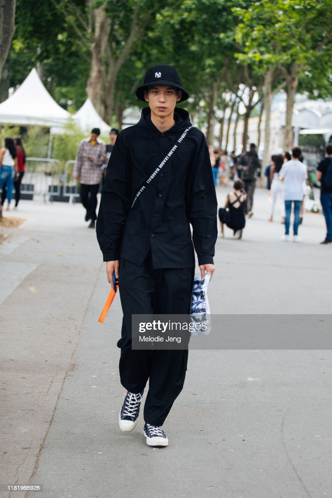A Model Wears An All Black Outfit New York Yankees Bucket Hat And News Photo Getty Images