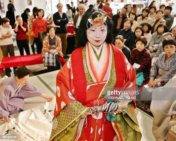 Model wears an ancient Japanese formal court ensemble called a junihitoe during a kimono show at Tokyo's Mitsukoshi department store 13 November 2005...