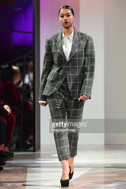 A model wears an ensemble by designer Andrew Nowell at the District of Fashion Fall/Winter 2019 Runway Show on February 07 2019 at the National...