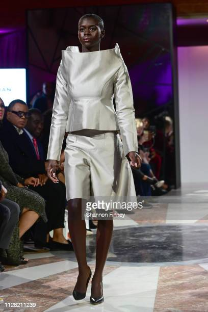 A model wears an ensemble by designer Shafei Han at the District of Fashion Fall/Winter 2019 Runway Show on February 07 2019 at the National Museum...