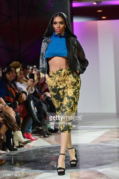 A model wears an ensemble from designer Amanda Casarez at the District of Fashion Fall/Winter 2019 Runway Show on February 07 2019 at the National...