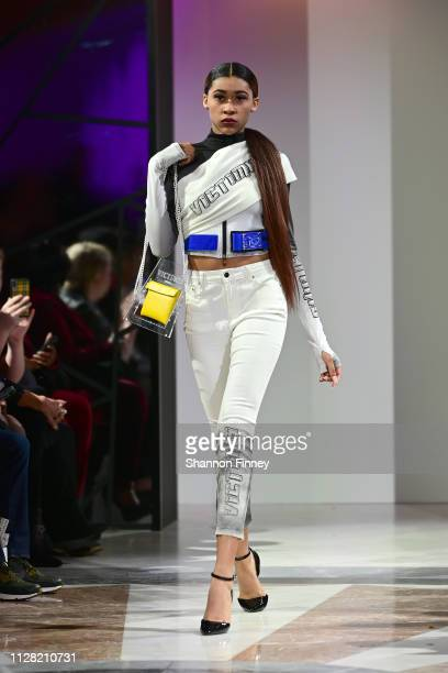 A model wears an ensemble from designer Shareef Mosby's Victim15 fashion line at the District of Fashion Fall/Winter 2019 Runway Show on February 07...