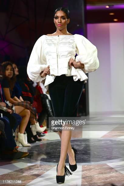 A model wears an ensemble from Planettogs at the District of Fashion Fall/Winter 2019 Runway Show on February 07 2019 at the National Museum of Women...