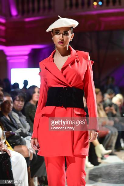 A model wears an ensemble from the Brittany Christina Collection at the District of Fashion Fall/Winter 2019 Runway Show on February 07 2019 at the...