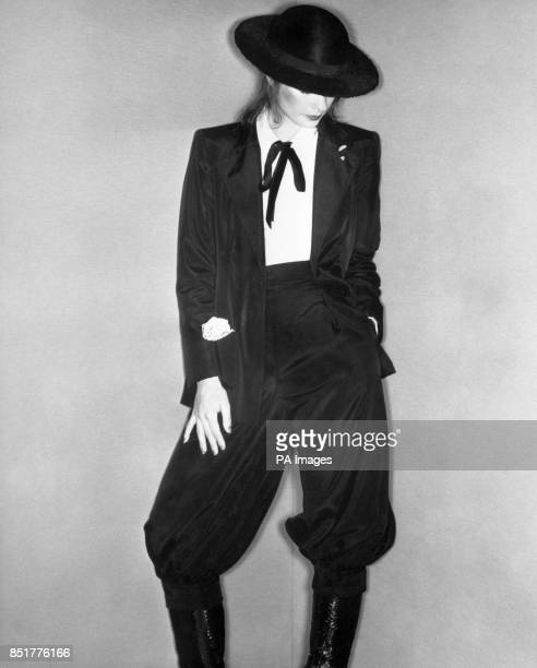 A model wears an evening outfit from Wallis featuring a tuxedo jacket and matching breeches